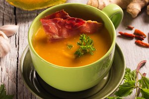 pumpkin soup in a green bowl