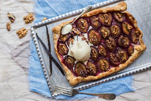 Rustic plum pie with walnuts