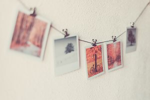 Some photos hanging on a rope