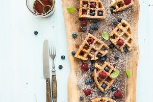Waffles with berries, honey and mint