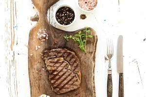 Grilled ribeye beef steak with herbs