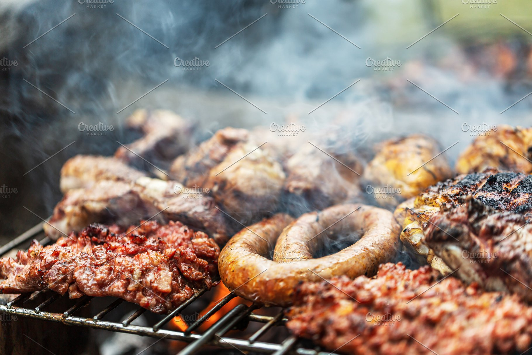 Barbeque grill mixed meat cooking on
