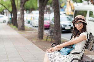 woman sitting on bench.