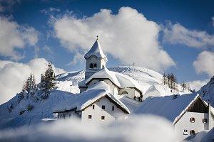 Village on mountains in Winter