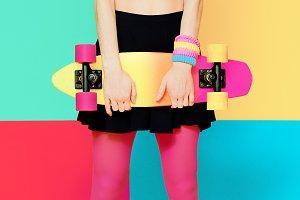 model holding skateboard