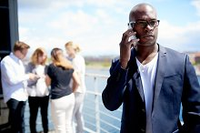 Black business man with a cell phone