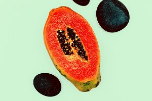 Fresh papaya and stones