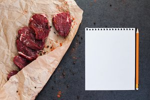 Mock-up with steak of beef on paper