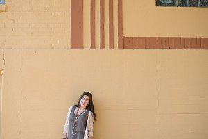 Model Against Yellow Wall
