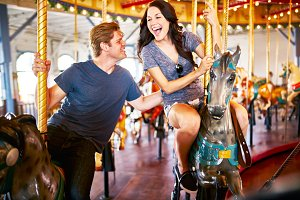 romantic couple riding carousel