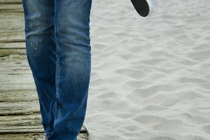 girl legs walking on the beach