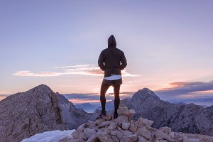 Male hiker at the top at sunset