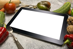 Digital tablet with fresh vegetables