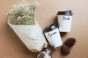 Bouquet of flower and coffee cup