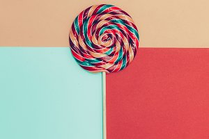 Lollipop on bright background