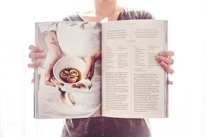 Girl holding a cookbook