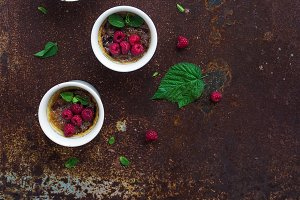 Creme brulees with raspberries