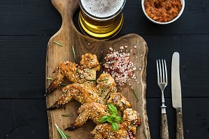 Fried chicken wings on serving board