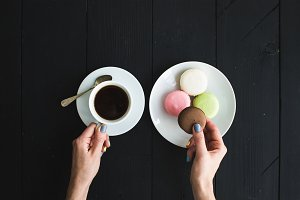 Macaron cookies and cup of espresso