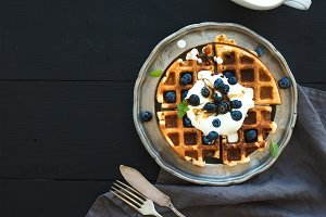 Waffles with blueberries and honey