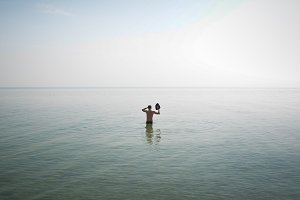 Man Goes to Silent Water at the Sea
