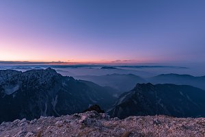 Dark & misty sunset in the alps