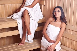 Two women enjoying a hot sauna