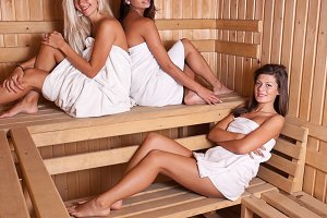 Three women enjoying a hot sauna