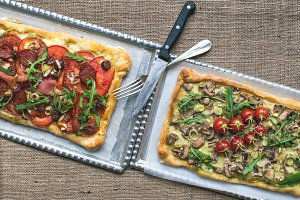 Two rustic square pizzas