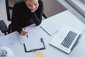 Woman analyzing chart of work