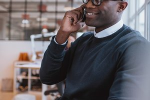 African executive using cell phone