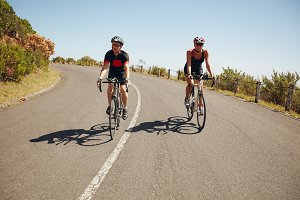 Cyclists riding down a country road