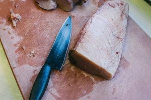 Knife and tuna loin in a kitchen