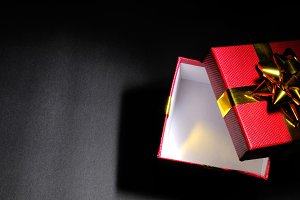 Empty open red gift box dim top