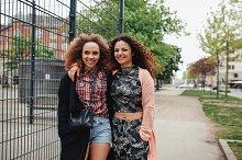 Joyful young women walking together