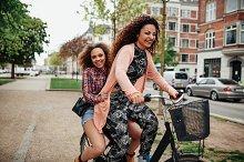 Young women enjoying bicycle ride