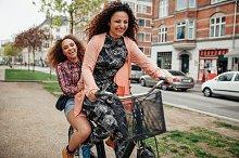 Two young girls having fun on bike