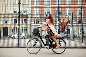 Two young women enjoying bike ride o