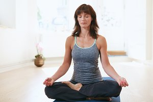 Fit woman in a meditative yoga pose