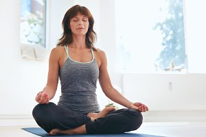 Fitness female practicing Padmasana