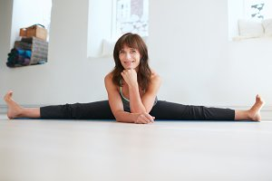 Flexible woman doing the splits