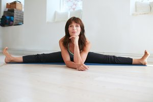 Fit mature woman doing yoga