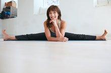 Happy woman practicing yoga poses