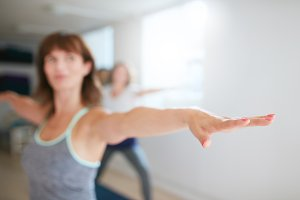 Woman working out in yoga class