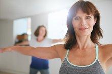 Women doing yoga workout at gym