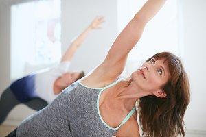 Fitness trainer doing Trikonasana