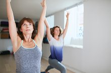 Two women practicing yoga forms