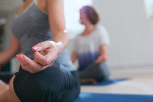Meditating woman's hand during yoga