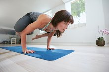 Fitness woman doing yoga handstand