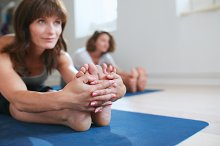 Women stretching together at yoga